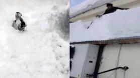 Çatıdaki karı temizlerken canından oluyordu