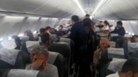 Uçakta gergin anlar! Yolcular tepki gösterdi, polis geldi