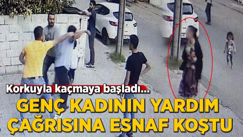 Çocuklarıyla kaçmaya çalıştı... Genç kadının yardımına esnaf koştu